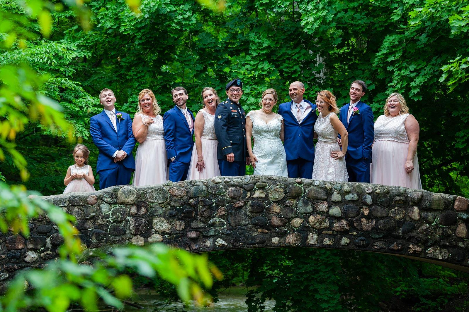 Wedding Photography - Fun Shot of Wedding Party on Stone Bridge - Paul Dekort Photographer