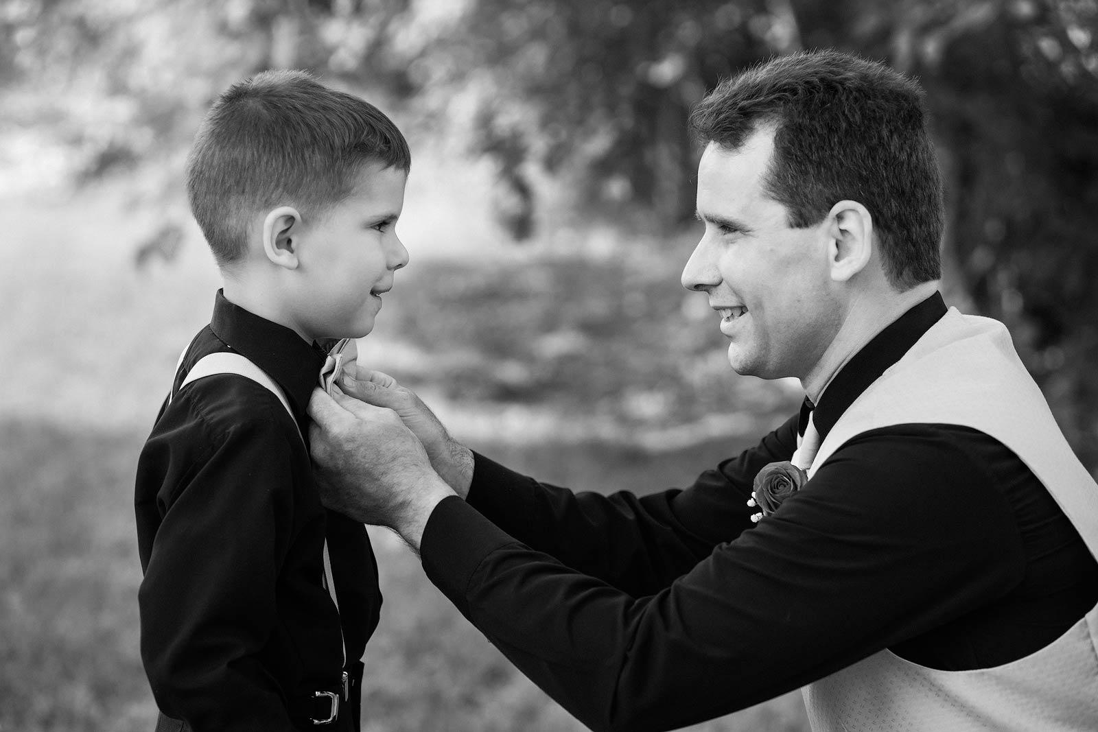 Wedding Photography - Father Helping Son Get Ready - Paul Dekort Photographer