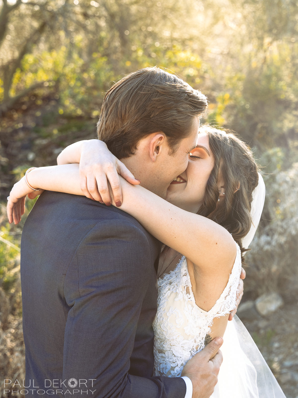 Photography of young couple kissing during their first look.
