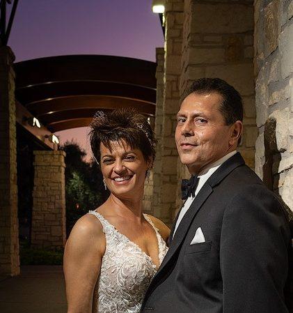 Twilight image of wedding couple at Occotillo CC in Chandler AZ